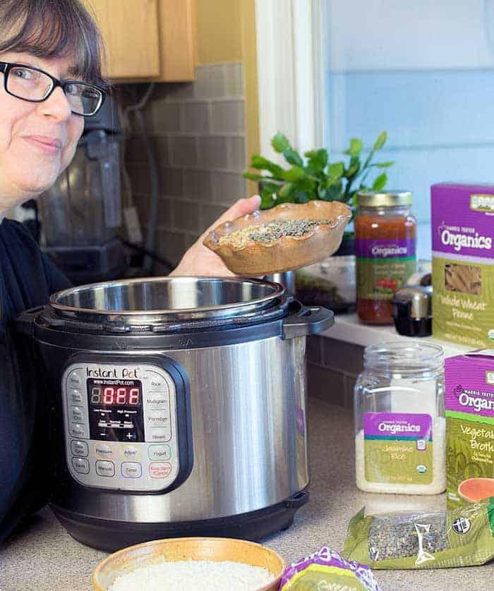 Kathy Hester pouring lentils into a 6-quart Duo Instant Pot