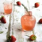 Instant Pot Strawberry Rosemary Infused Water in an etched glass pitcher