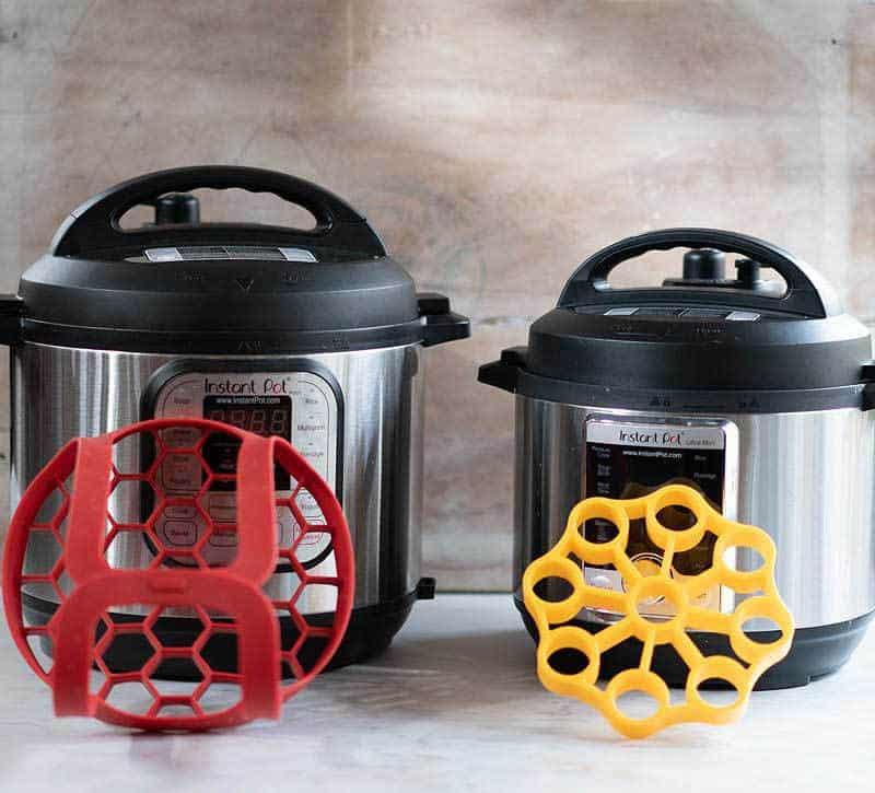 OXO Instant Pot accessories - bakeware sling and egg cooker/jar leveler in front of Instant Pot