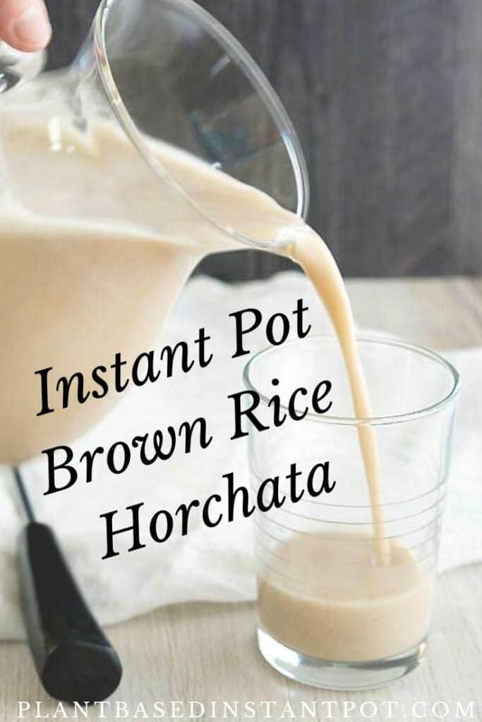 Instant Pot Brown Rice Horchata pouring out of a glass pitcher into a drinking glass.