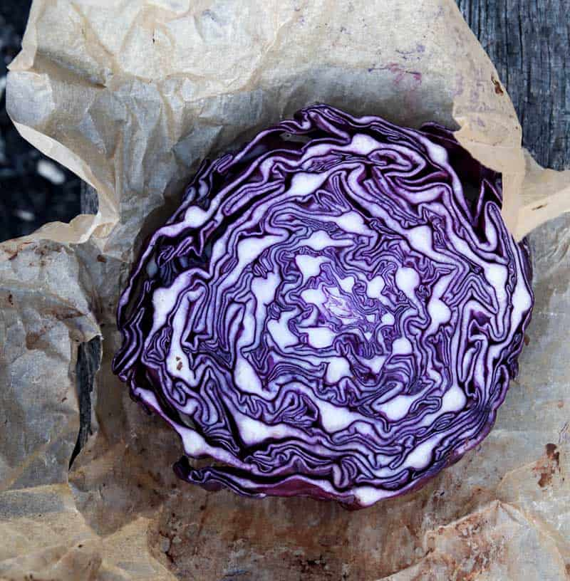 red cabbage cut in half on parchment