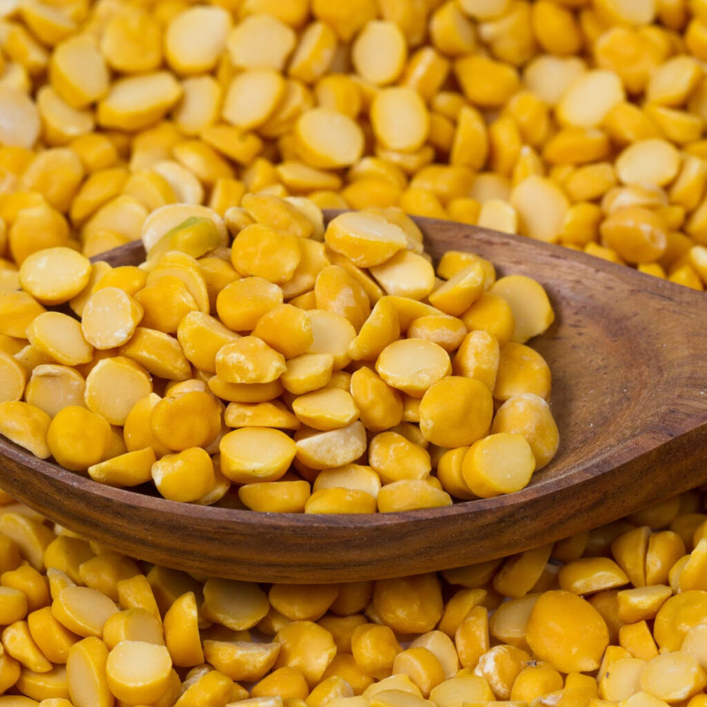 Channa dal in a wooden bowl - skinned and split baby chickpeas